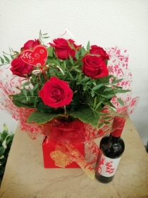 6 Red Rose Handtied with Wine